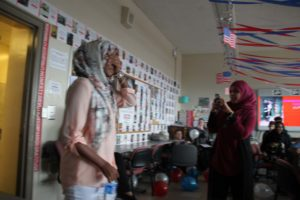 Razan closes her eyes as she enters the room to be surprised by her classmates