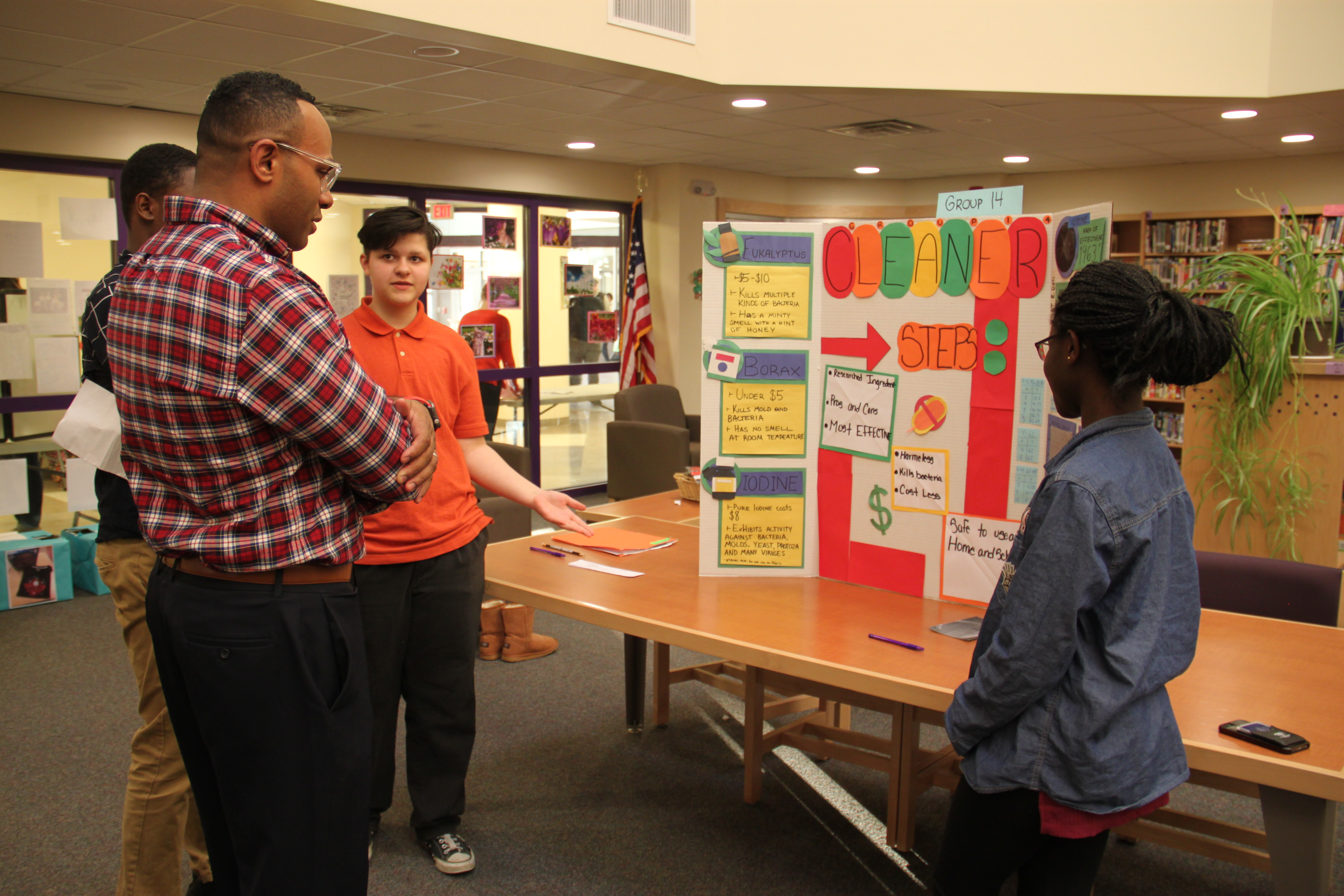 P-TECH students present their findings to Dr. Casey Parker