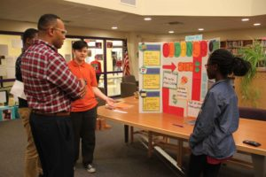 P-TECH students present their project to Dr. Parker