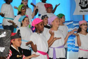 """Students singing during the 2016 performance of """"Pirates: The Musical."""""""