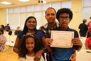 P-Tech student and his family at induction ceremony.
