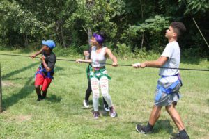 Students working together to pull a rope