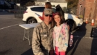 Dad in military uniform and young daughter