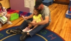 Dad reading to young daughter