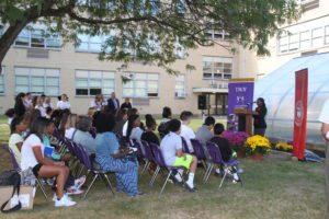 Crowd looks on as student Anya Burke speaks