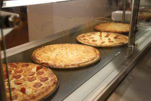 Four pizzas. Two pepperoni, two cheese.