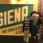Student and siena mascot