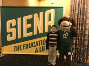 Student and siena mascot