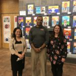 Teachers in front of art work