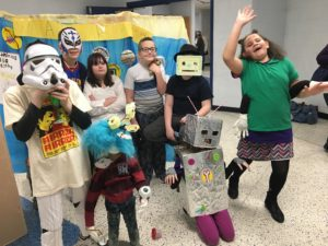 Students in costumes smile for the camera