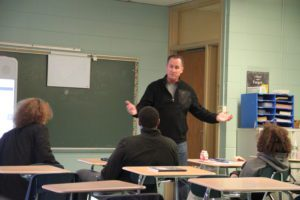 Detective Millington speaks to School 12 students about interacting with police officers.