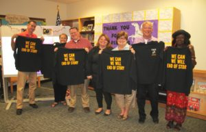 """BOE Members holding shirts that say """"We can, we will, end of story."""""""