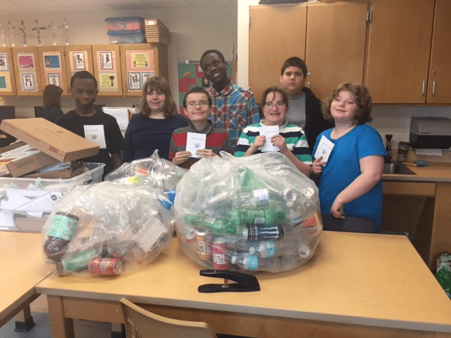 Students and their bag of recyclables