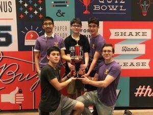 Troy High Quiz Bowl team holding their trophy