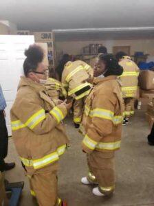 Female students in fire gear