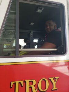 Student sitting in a firetruck
