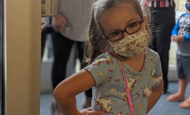 Kindergarten girl with mask on